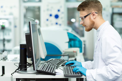 Scientist using computer in lab